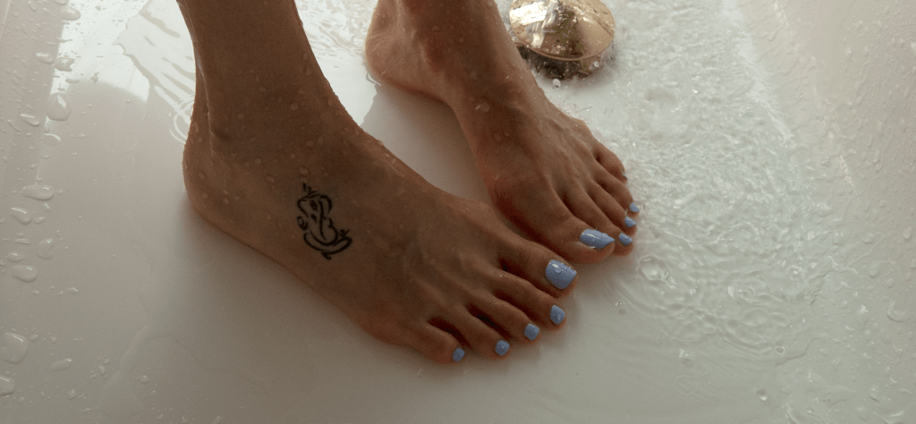 Smooth Feet with Tattoo and Pedicured Nails